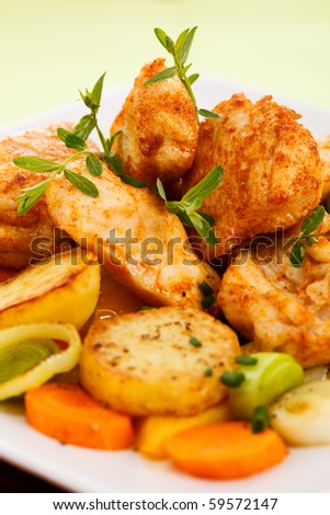 Roasted meat with fried potatoes and vegetables - stock photo