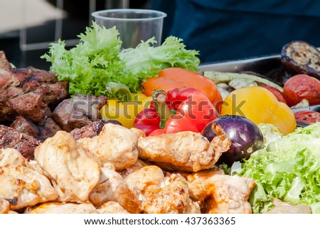roasted meat with vegetables on the grill