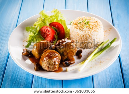 Roasted meatballs, rice and vegetables - stock photo