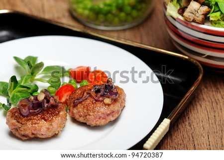 Roasted meatballs with red onion - stock photo