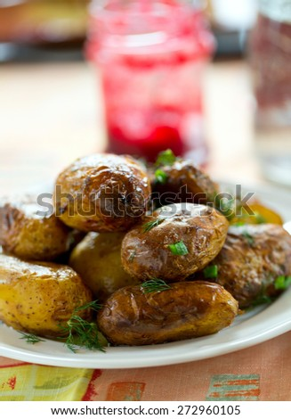 roasted new potatoes on white plate