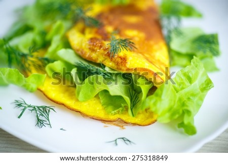 Roasted omelet with lettuce on a plate - stock photo