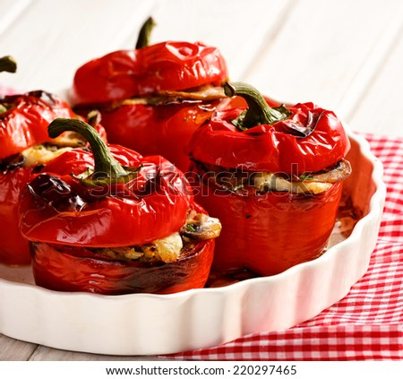 Roasted peppers stuffed with rice, cheese and mushrooms - stock photo