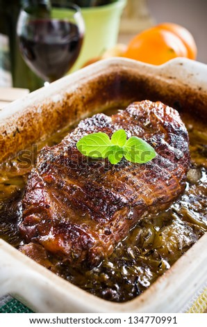 Roasted piece of lamb meat in dark gravy
