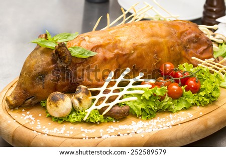 roasted pig with herbs and vegetables