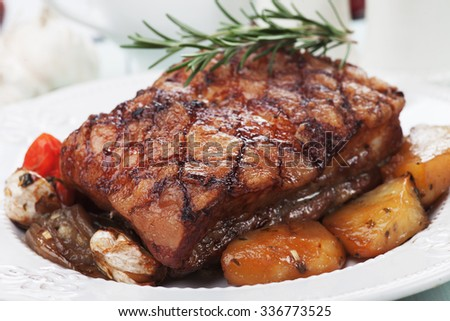 Roasted pork belly or bacon with rosemary and spicy potato