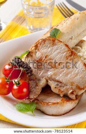 Roasted pork chops and whole grain roll