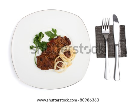 Roasted Pork Chops with Onion. Isolated with clipping path. - stock photo