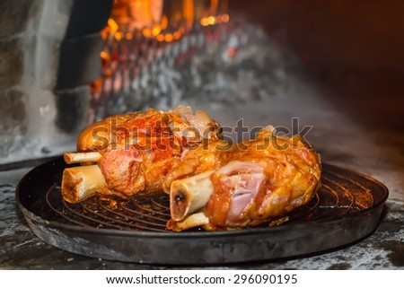 Roasted pork knuckle baked in a brick oven - stock photo
