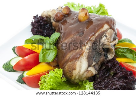 roasted pork knuckle with vegetables - stock photo