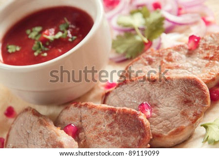 Roasted pork loin steaks with tomato sauce on scone - stock photo