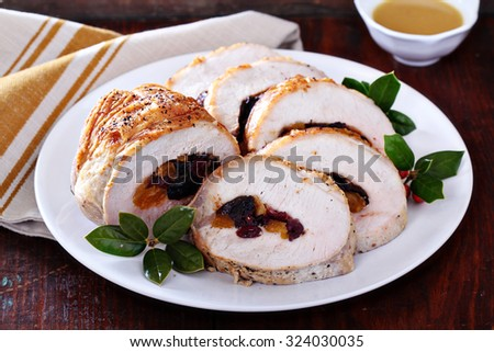 Roasted pork loin stuffed with dried fruits for Christmas table - stock photo