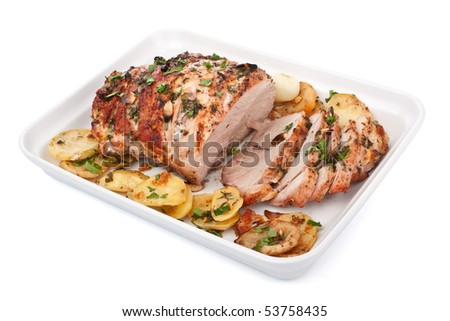Roasted Pork Loin with Garlic Herbs and Sliced Potatoes - stock photo