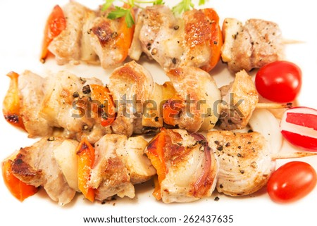 Roasted pork meat with vegetables on a white plate - stock photo