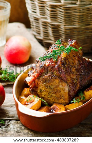 Roasted Pork Rack with Apples.style rustic.selective focus