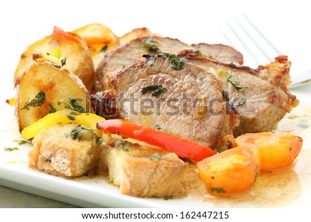 roasted pork with potatoes isolated on white (top) - stock photo
