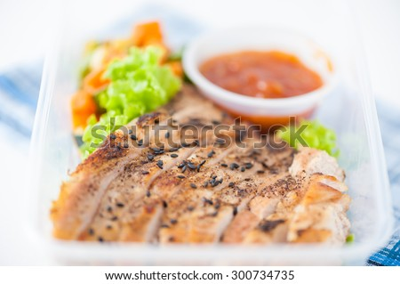 Roasted pork with three flavoured (sweet, sour, spicy) sauce cooked by clean food concept with vegetables in lunch box - stock photo