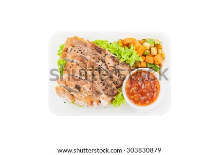 Roasted pork with three flavoured (sweet, sour, spicy) sauce cooked by clean food concept with vegetables in lunch box isolated on white background - stock photo