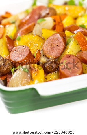 Roasted Potato and Grilled Sausage Stew Dinner. Selective focus. - stock photo