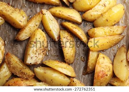 Roasted potato on a baking sheet - stock photo