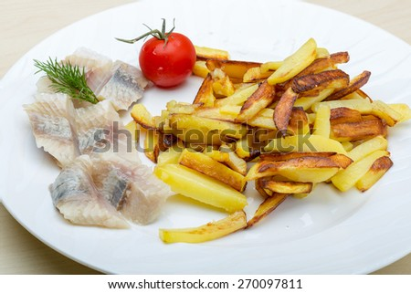 Roasted potato with herring fillet and dill - stock photo