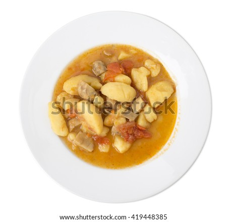 Roasted potato with mushrooms and pork. Isolated on a white background.  - stock photo