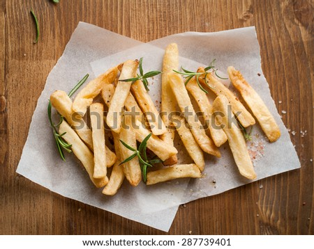 Roasted potato with rosemary and salt, selective focus - stock photo