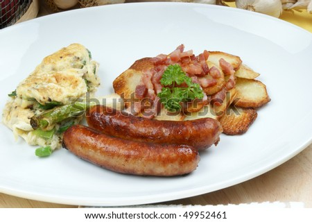 roasted potato with sausage on a white plate