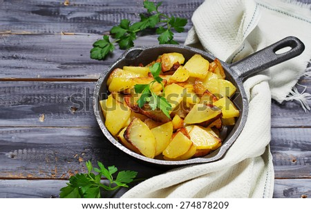 Roasted potatoes in a pan. Selective focus. Space for text - stock photo