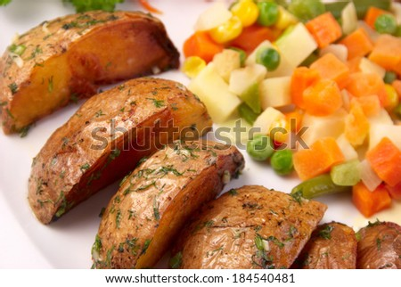 roasted potatoes with vegetables - stock photo