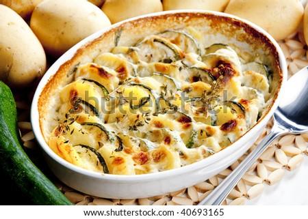 roasted potatoes wth zucchini - stock photo