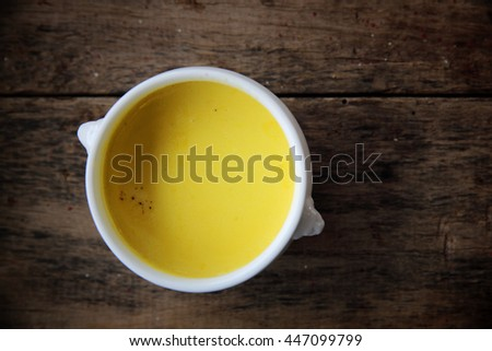 Roasted pumpkin soup on wooden background - stock photo