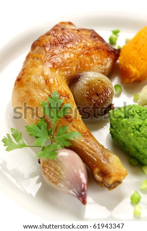 Roasted quarter of chicken with a pea, potato and butternut mash. - stock photo