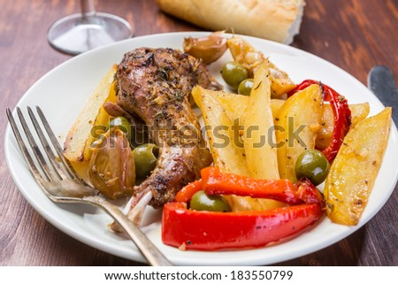 Roasted Rabbit Legs with Vegetables - stock photo