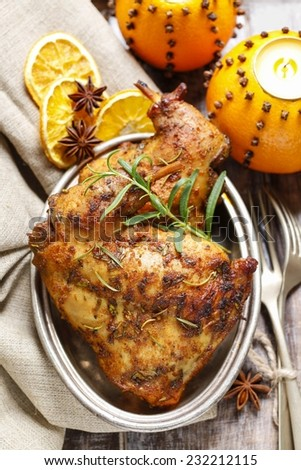 Roasted rabbit with herbs - stock photo