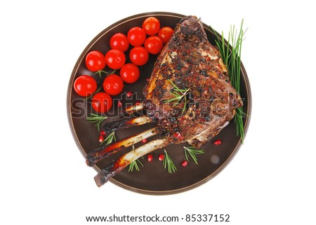 roasted rack of ribs served on plate