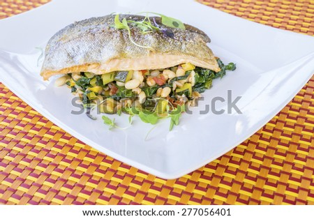 Roasted Rainbow Trout On a Bed of Fresh Spring Vegetables - stock photo