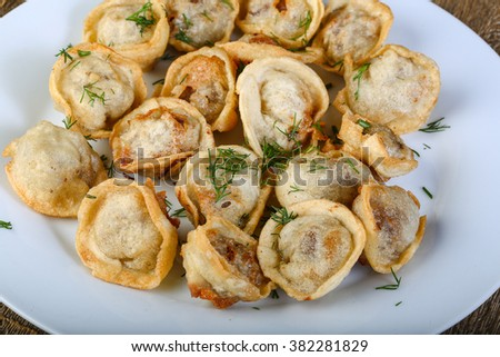 Roasted Russsian dumplings with green dill