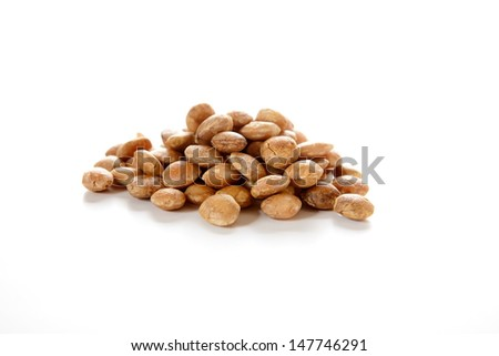 Roasted sacha inchi seeds, good source of plant based omega 3 fatty acids. Plukenetia volubilis. - stock photo