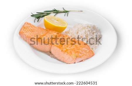 Roasted salmon fillets with rice. Whole background.  - stock photo