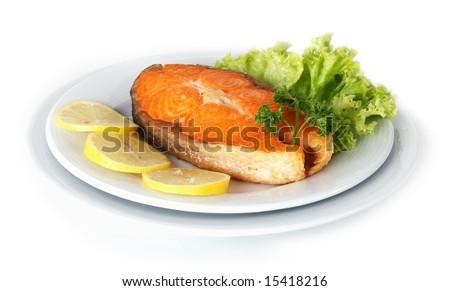 Roasted Salmon plated with lemon - stock photo