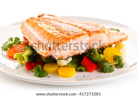 Roasted salmon steak and vegetables