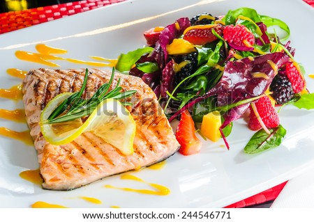 Roasted salmon with berry side dish. - stock photo