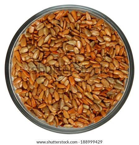 Roasted Salted Sunflower Seeds in Bowl High Angle View Over White - stock photo