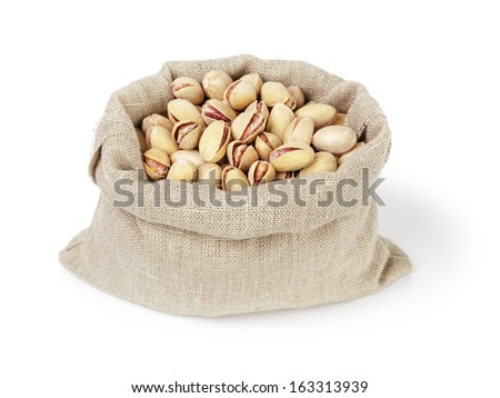 roasted salty pistachios nuts in sack bag, isolated on white background - stock photo