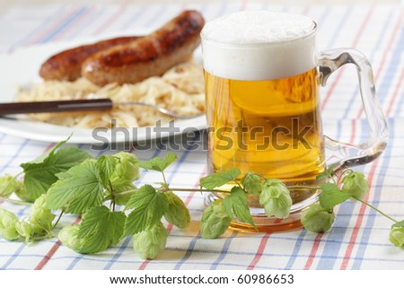 Roasted sausage with braised cabbage and beer - stock photo
