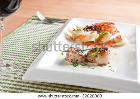 Roasted scallops, pasta and shrimp - stock photo