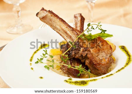 Roasted sheep meat with bones on dish  in restaurant