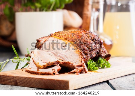 Roasted shoulder on a cutting board  - stock photo