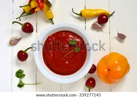 Roasted sweet pepper sauce, dip, top view - stock photo